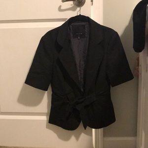 Short sleeved black jacket.